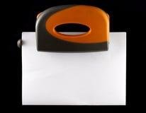 Perforatore con il foglio di carta Fotografie Stock Libere da Diritti