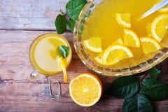 Perforazione arancio con la bevanda dolce di estate dell'alcool della frutta Immagine Stock Libera da Diritti