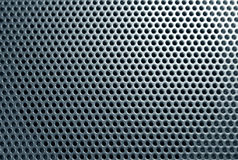 Perfored plastic. Perforation texture close-up stock photos