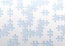 Perforiertes Papier mit Puzzlestücken Stockfotos