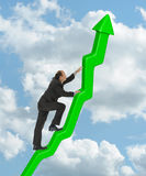 Performance. Businessman climbing a steep graph chart Stock Image