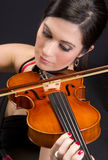 Female Musician on Plays Song on String Viloin Royalty Free Stock Photo