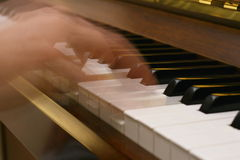 The performance. Person playing piano with motion blur to show movement for musical concept Stock Photo