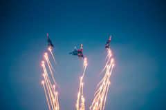 The performance of the aircraft of the Russian Knights. In a dark blue sky with fireworks Royalty Free Stock Photo