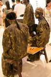 Performance art, Bronzemen Stock Images