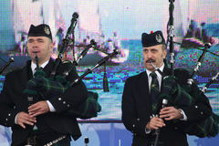 Performance artists, orchestra,   ensemble Scottish national musical instruments pipes and drums. Stock Photo