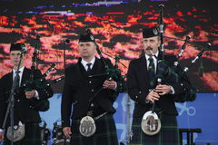 Performance artists, orchestra,   ensemble Scottish national musical instruments pipes and drums. Royalty Free Stock Photography