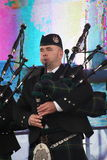 Performance artists, orchestra,   ensemble Scottish national musical instruments pipes and drums. Royalty Free Stock Photos