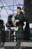 Performance artists, orchestra,   ensemble Scottish national musical instruments pipes and drums. Royalty Free Stock Image
