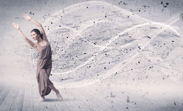 Performance ballet dancer jumping with energy explosion particle Stock Photo
