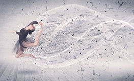 Performance ballet dancer jumping with energy explosion particle Stock Photos