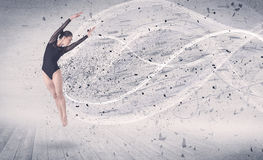 Performance ballet dancer jumping with energy explosion particle Royalty Free Stock Photo