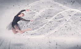 Performance ballet dancer jumping with energy explosion particle Stock Images