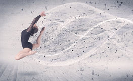 Performance ballet dancer jumping with energy explosion particle Royalty Free Stock Photography