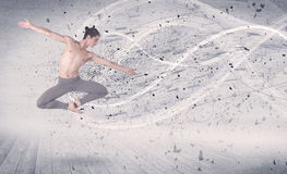 Performance ballet dancer jumping with energy explosion particle Royalty Free Stock Images