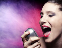Performance of a beautiful woman singer stock image