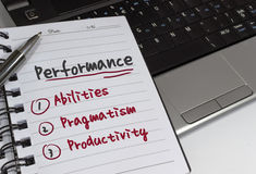 Performance. Bullet points on notepad and office supplies Royalty Free Stock Photography