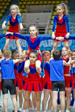Performance of children cheerleaders team stock photos