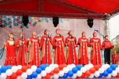 Performance of childrens national chorus on street scene of city Royalty Free Stock Photography