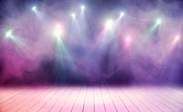 Performance concept. Wooden stage with pink smoke and spot lights. Performance concept Royalty Free Stock Images