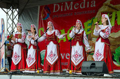 Performance of creative choral collective during Shrovetide fest Royalty Free Stock Photo