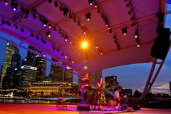 Performance at Esplanade Outdoor  theater  Singapore. Free performance at Esplanade Outdoor theatre Singapore. Fronting the 300m long waterfront along Marina Bay Royalty Free Stock Image