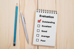 Performance evaluation check box on notebook with pen and pencil.  Stock Photo