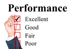 Performance evaluation form. Tick excellent by businessman Royalty Free Stock Photo