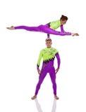 Performance of flexible acrobats in studio Stock Images