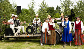A performance of folk ensemble is in the Latvian national suits Stock Photo