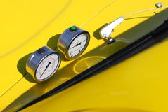 Performance gauges. Performance pressure and oil temperature gauges on a beautiful yellow dragster Stock Photography
