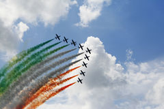Performance from Italy flying team. A shot of the flying performance from italy airforce during the openday of Leeuwaarden airforce, the show uses different royalty free stock photos