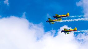 3 performance jets, flying in tandem, on a blue sky with white clouds stock image