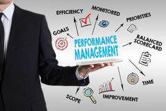 Performance Management concept. Young man holding a tablet compu Royalty Free Stock Photos