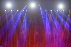 Performance moving lighting on construction light beam ray. Downward in yellow blue color, on Concert and Fashion Show stage ramp Royalty Free Stock Photo