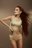 Performance. Red Head Woman in Stagy Costume Stock Photo