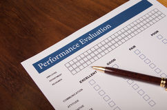 Performance Review form. Performance Evaluation form with a pen on a desk royalty free stock image