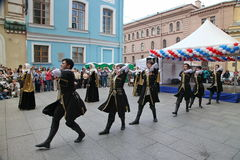 The performance of soloists-dancers of the ensemble Imamat (solar Dagestan) with traditional dances of the North Caucasus. Dance of the highlanders. the Royalty Free Stock Image
