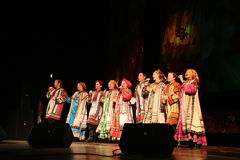 The performance on the stage of actors, soloists, singers and dancers of the national theatre  russian song Stock Photo