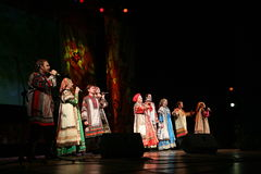The performance on the stage of actors, soloists, singers and dancers of the national theatre  russian song Stock Images
