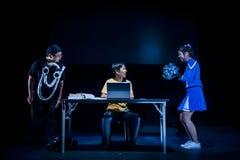 Performance on stage in dark studio Stock Photo