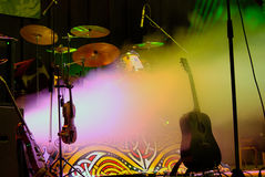 Performance starts. Empty stage with instruments ready for performance Royalty Free Stock Photo