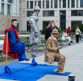 Performance on the street. Artists stand motionless for a long time Stock Image