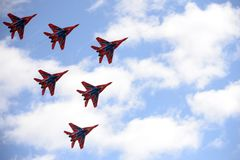 Performance of the Swifts aerobatic team on multi-purpose highly maneuverable MiG-29 fighters over the Myachkovo airfield. MOSCOW, RUSSIA APRIL 27, 2018 stock image