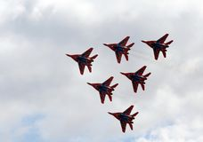 Performance of the Swifts aerobatic team on multi-purpose highly maneuverable MiG-29 fighters over the Myachkovo airfield royalty free stock photo
