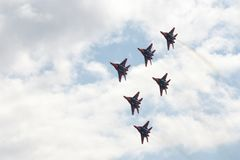 Performance of the Swifts aerobatic team on multi-purpose highly maneuverable MiG-29 fighters over the Myachkovo airfield stock photography