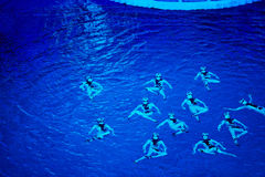 Performance of synchronized swimmers Stock Photography