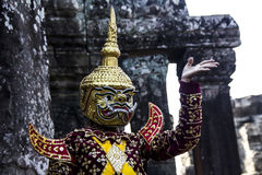 Performance on top of Angkor Wat. The picture was taken on top of the main building in Angkor Wat. An actor is performing with a traditional costume Stock Image