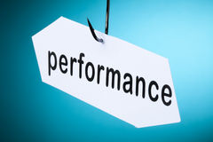 Performance word on hook Stock Photos