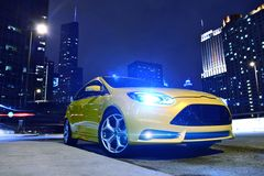 Performance Yellow Car. In Downtown Chicago. Fast and Furious. Car at Night - Urban Theme. Performance Vehicles Photography Collection Stock Photo